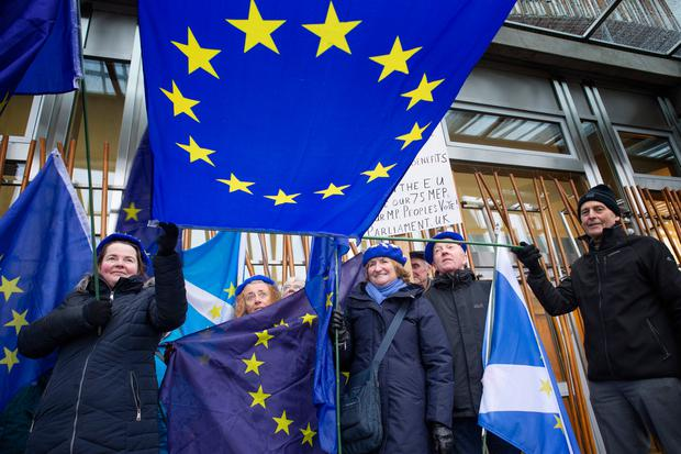 Pro-European protestors outside the Scottish Parliament, Edinburgh, as a vote is held against Theresa May's proposed Brexit deal with MSPs calling instead for a 'better alternative' to the PM's plans to be taken forward. Photo: Jane Barlow/PA Wire