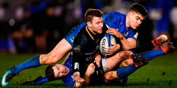 Bath's Will Chudley is tackled by Luke McGrath and Garry Ringrose of Leinster. Photo: Ramsey Cardy/Sportsfile