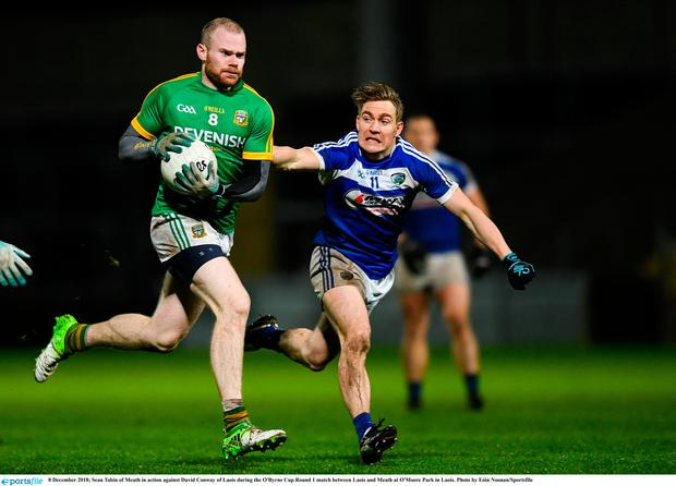 8 December 2018; Sean Tobin of Meath in action against David Conway of Laois during the O'Byrne Cup Round 1 match between Laois and Meath at O'Moore Park in Laois. Photo by Eóin Noonan/Sportsfile
