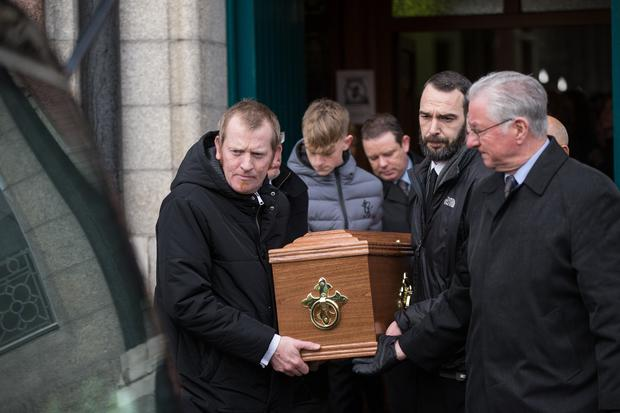 The remains of Actor Dónall Farmer are brought from St. Joseph's Church, Terenure by his son Dónall (on left) and family members after his funeral mass. Pic:Mark Condren