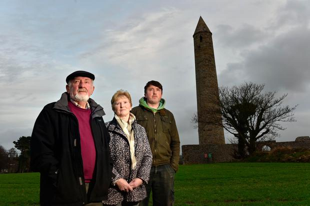TRAUMATIC: Seamus, Margaret and James O'Mahony in their field beside Rattoo Tower. Photo: Don MacMonagle