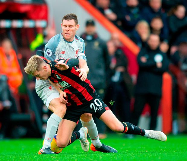 Liverpool's James Milner tackles Bournemouth's David Brooks. Photo: Mark Pain/PA Wire