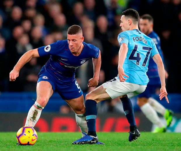 Chelsea's Ross Barkley (left) and Manchester City's Phil Foden battle for the ball during the match at Stamford Bridge. Photo: Adam Davy/PA
