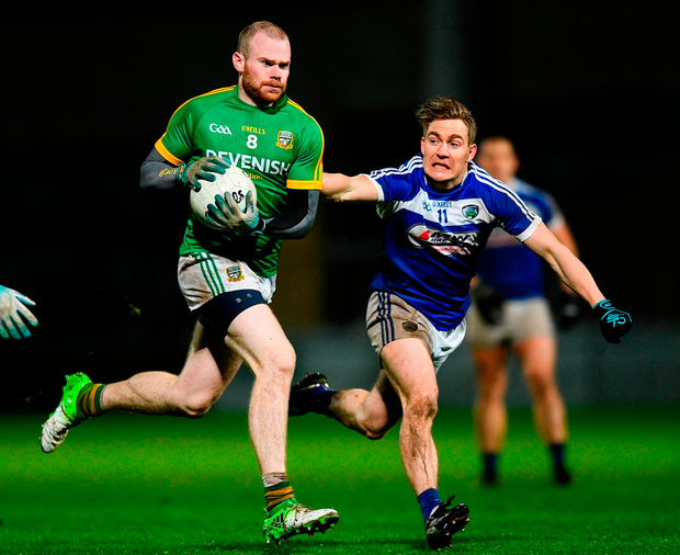 Meath's Sean Tobin in action against David Conway of Laois during the O'Byrne Cup Round 1 match. Photo: Eóin Noonan/Sportsfile