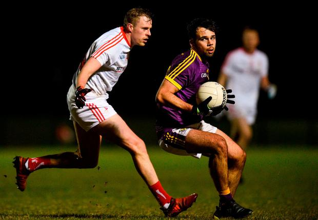 Wexford's Conor Devitt in action against Louth's Sam Mulroy. Photo: David Fitzgerald/Sportsfile