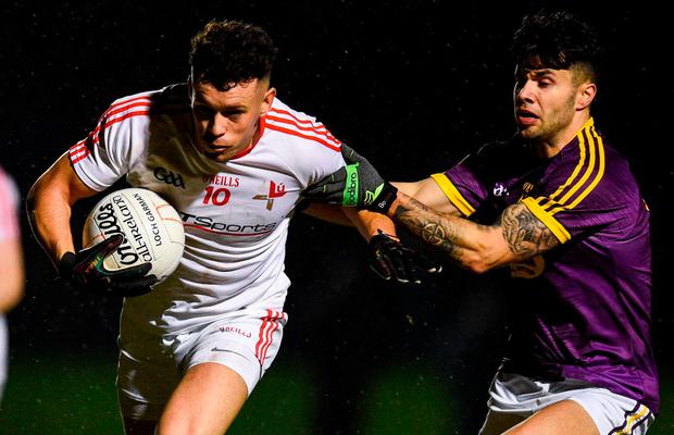 Louth's Conor Brannigan in action against Wexford's Paul Curtis. Photo: David Fitzgerald/Sportsfile