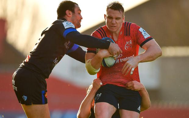 Rory Scannell of Munster is tackled by Thomas Combezou and Antoine Tichit of Castres Olympique during the European Rugby Champions Cup Pool 2 Round 3 match between Munster and Castres at Thomond Park in Limerick. Photo by Brendan Moran/Sportsfile