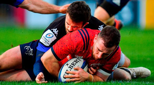 JJ Hanrahan of Munster score his side's third try despite the tackle of Taylor Paris of Castres Olympique during the European Rugby Champions Cup Pool 2 Round 3 match between Munster and Castres at Thomond Park in Limerick. Photo by Brendan Moran/Sportsfile