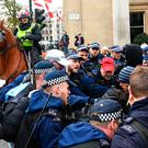 Police officers attempts to keep rival protesters from clashing in Trafalgar Square, London, as people take part in an anti-fascist counter-demonstration against a