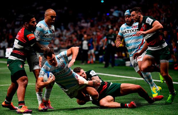 Racing 92's Argentinian winger Juan Imhoff (3rdL) is tackled by Leicester's English wing Adam Thompstone (3rdR) during the European Rugby Champions Cup union match between Racing 92 and Leicester Tigers at the Paris La Defense Arena stadium in Nanterre, near Paris on December 9, 2018. (Photo by Anne-Christine POUJOULAT / AFP)ANNE-CHRISTINE POUJOULAT/AFP/Getty Images