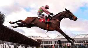 Min, with Ruby Walsh up, jumps the last on the way to winning the John Durkan Memorial Chase at Punchestown. Photo by Seb Daly/Sportsfile