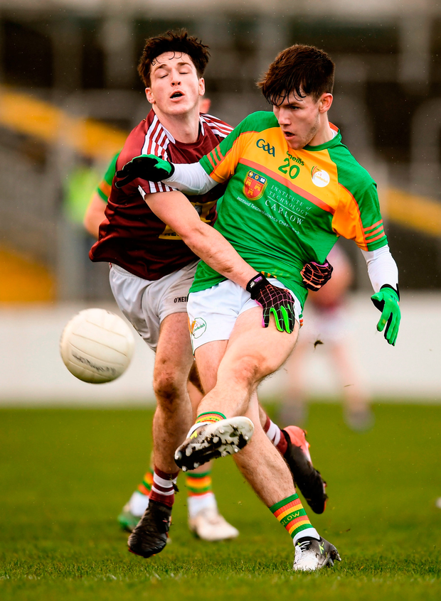 Josh Moore of Carlow in action against James Maxwell of Westmeath. Photo by Stephen McCarthy/Sportsfile