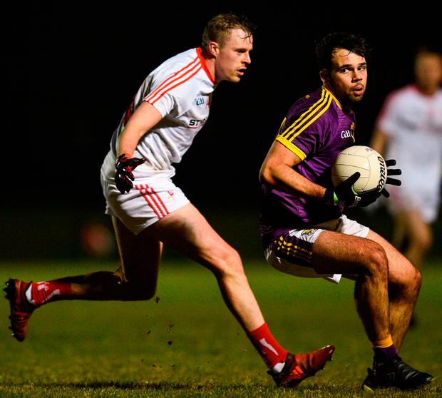 Wexford's Conor Devitt tries to get away from Sam Mulroy during the O'Byrne Cup match in Darver. Photo by David Fitzgerald/Sportsfile