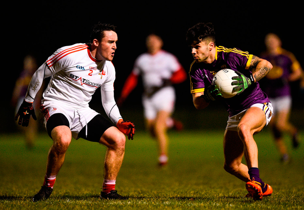 Paul Curtis of Wexford in action against James Craven of Louth. Photo by David Fitzgerald/Sportsfile