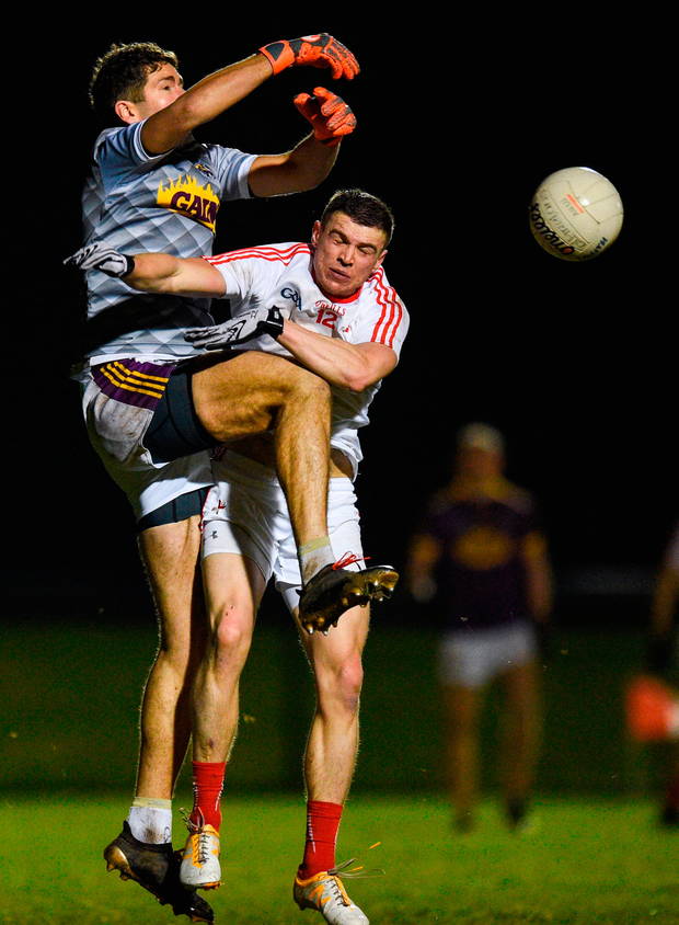 Conor Swaine of Wexford in action against Conaill McKeever of Louth. Photo by David Fitzgerald/Sportsfile