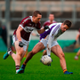 Marked man: Paul Mannion finds space at a premium as Patrick Fox puts him under pressure at Bord na Móna O'Connor Park. Photo by Daire Brennan/Sportsfile