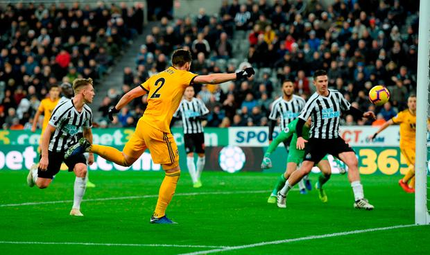 Wolves player Matt Doherty scores the winning goal. Photo by Stu Forster/Getty Images