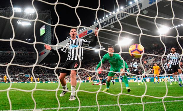 Newcastle defender Ciaran Clark (l) and goalkeeper Martin Dubravka look on as the winning Wolves goal goes into the net. Photo by Stu Forster/Getty Images