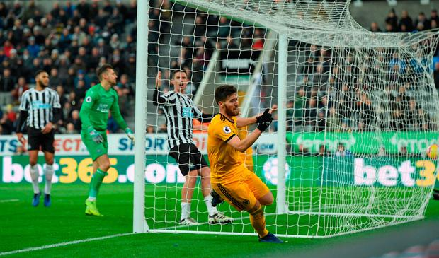 Wolves player Matt Doherty celebrates the winning goal. Photo by Stu Forster/Getty Images