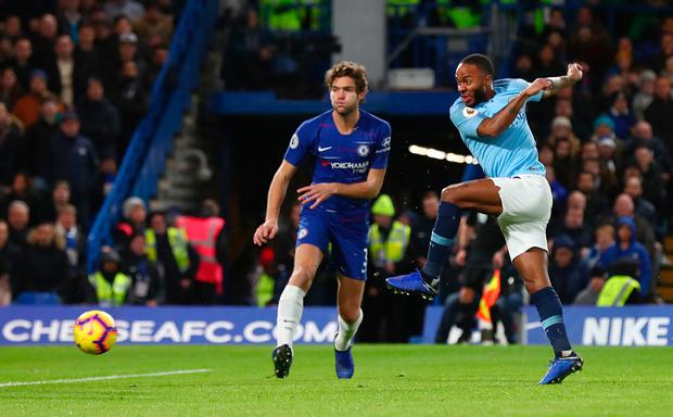 Raheem Sterling gets a shot on goal despite the close attention of Marcos Alonso. Photo: Getty Images