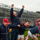 Mullinalaghta substitutes and officials react at the final whistle after their stunning victory in the Leinster club SFC final against Kilmacud Crokes in O'Connor Park. Photo: Sportsfile