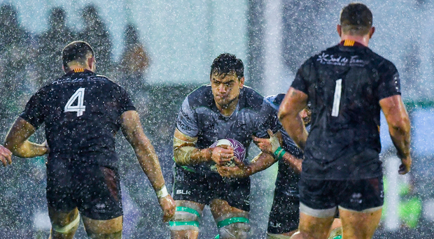 Quinn Roux tries to make his way through the Perpignan defence and the rain at The Sportsground. Photo: Sportsfile