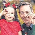 No Nollaig: RTÉ presenter Ryan Tubridy and little helper Lauren Cronje, from Dublin, launch the 2018 Christmas Stamp collection from An Post
