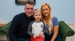 Quiet time: Maurice Nolan and Emma Smith-Nolan with son Alex (6) at the event in the Mansion House. Photo: Doug O'Connor
