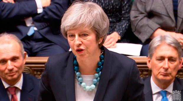 British Prime Minister Theresa May making a statement in the House of Commons, London, where she told MPs that tomorrow's
