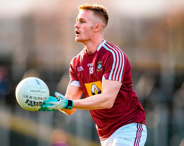 Westmeath's Killian Daly handpassing the ball during Sunday's O'Byrne Cup clash. Photo: Stephen McCarthy/Sportsfile