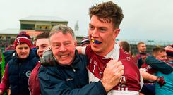 John Keegan celebrates with Mullinalaghta supporters after Sunday's Leinster club final win. Photo: Daire Brennan/Sportsfile