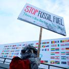 An environmental activist protests against fossil fuel in front of the the venue of the COP24 UN Climate Change Conference 2018 in Katowice, Poland. Photo: REUTERS