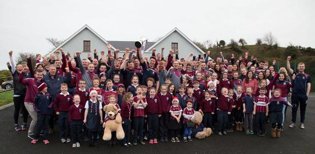 Home are the heroes: Mullinalaghta players celebrate with pupils at St Columba's National School in Co Longford yesterday. Photo: Colin O'Riordan
