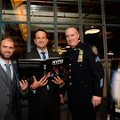 10 Dec 2018; Photographer Mark Condren, Taoiseach Leo Varadkar and Det. Sgt. Johnny Moynihan (NYPD Joint Terrorist Task Force), look at the book. Taoiseach Leo Varadkar officially launches photographer Mark Condren's photo book 'NYPD' - Behind the scenes with the men and women of the New York City Police Department. Guinness Storehouse, Dublin. Picture: Caroline Quinn