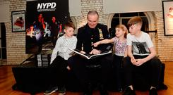 Det Sgt Johnny Moynihan of the NYPD Joint Terrorist Task Force, who features in the book, with photographer Mark Condren's children: Aaron (9), Emma (7), and Ben (12). Photo: Caroline Quinn