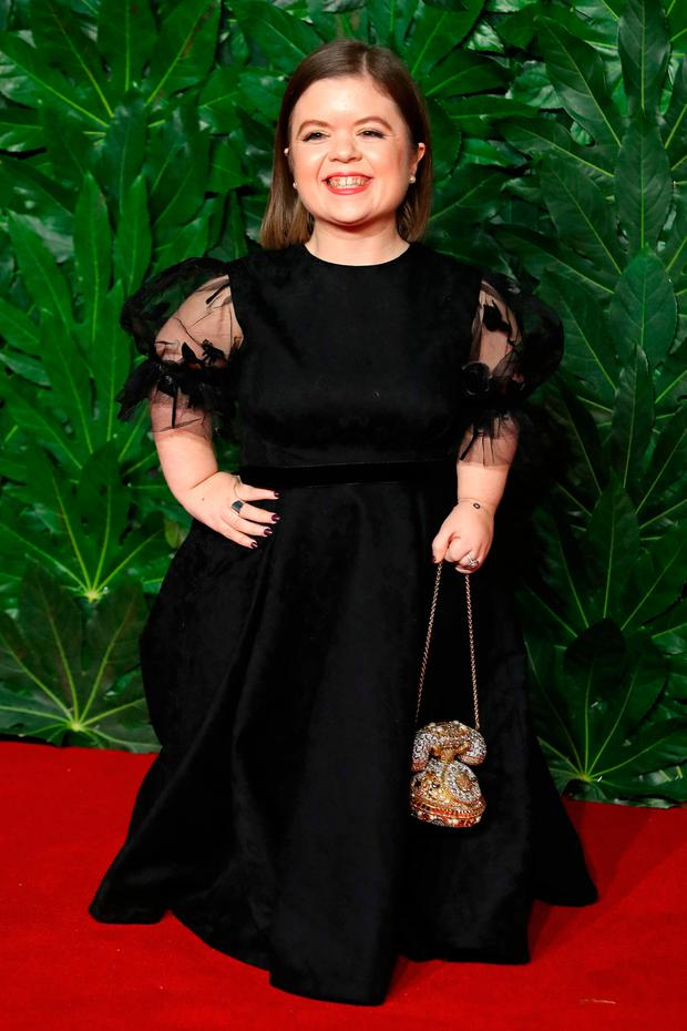 Irish writer Sinead Burke poses on the red carpet upon arrival to attend the British Fashion Awards 2018 in London on December 10, 2018