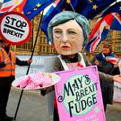 Protest: A demonstrator dressed as Theresa May sells Brexit fudge at Westminster. Photo: PA
