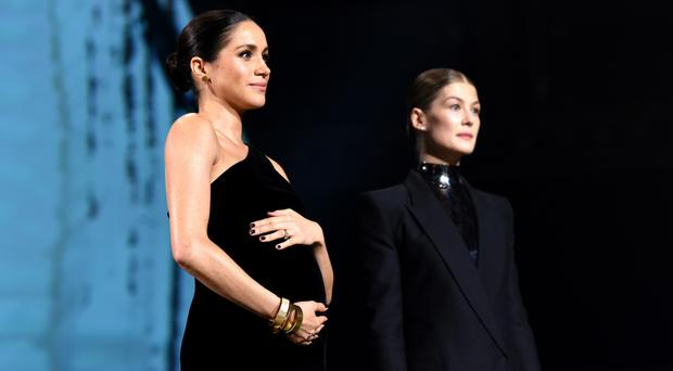 Meghan, Duchess of Sussex and Rosamund Pike on stage during The Fashion Awards 2018 In Partnership With Swarovski at Royal Albert Hall on December 10, 2018 in London, England. (Photo by Joe Maher/BFC/Getty Images)