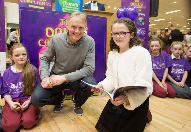 Page turner: Author Keeva Delaney, (11), from Ballycarney, Co Carlow, with rugby coach Joe Schmidt, to sign her book 'The Dolls' Complaints'. Photo: Liam Burke/Press 22
