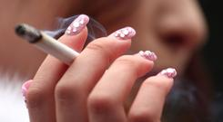 Every cigarette smoked contains over 4,000 chemicals, so smoking when pregnant harms the unborn baby. Stock Image