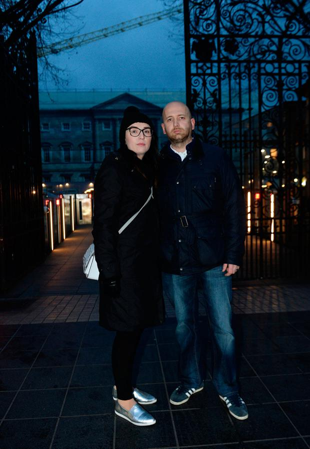 11 Dec 2018: Conor Blighe and partner Jennifer, from Saggart. Members of 221+ group for women affected by the cervical cancer scandal, protest outside Leinster House, afer meeting with Simon Harris, due to take place today, was cancelled. Leinster House, Kildare Street, Dublin. Picture: Caroline Quinn