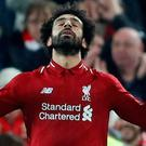 Liverpool's Mohamed Salah celebrates scoring their first goal