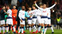 Spurs players celebrate reaching the Champions League last 16.