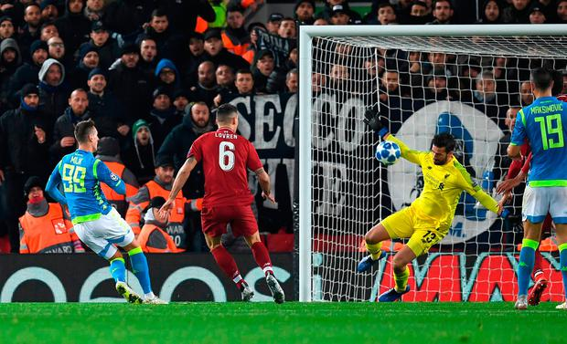Liverpool goalkeeper Alisson makes a crucial late save from Napoli's Arkadiusz Milik. Photo: PAUL ELLIS/AFP/Getty Images