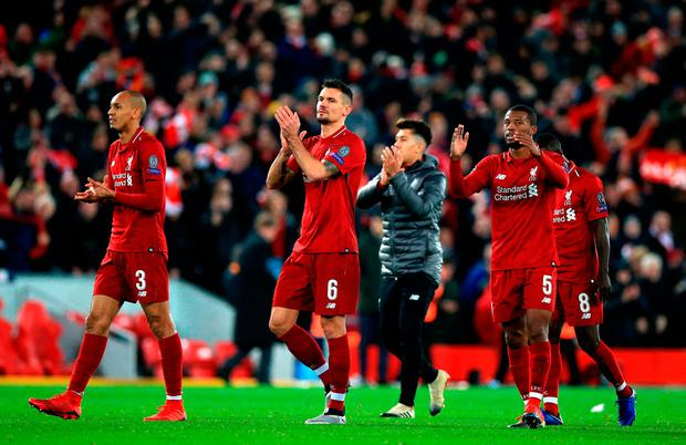 Liverpool players applaud fans after the match. Photo: Peter Byrne/PA Wire