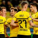 Borussia Dortmund's Raphael Guerreiro celebrates scoring their second goal with Paco Alcacer and Mario Goetze. Photo: REUTERS/Eric Gaillard