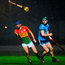 Tom Connolly can only look on as Carlow's Seán Whelan gets the sliotar away despite losing his hurley during the Walsh Cup match at Netwatch Cullen Park. Photo by Harry Murphy/Sportsfile