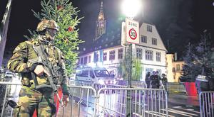 Emergency: The French military secure the area where the shooting took place at a Christmas market. Photo: REUTERS/Christian Hartmann