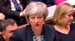 Dramatic scenes: Prime Minister Theresa May makes her statement in the Commons delaying the Brexit vote. Photo: AFP/Getty Images