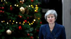 Britain's Prime Minister Theresa May addresses the media outside 10 Downing Street after it was announced that the Conservative Party will hold a vote of no confidence in her leadership, in London, Britain, December 12, 2018. REUTERS/Peter Nicholls